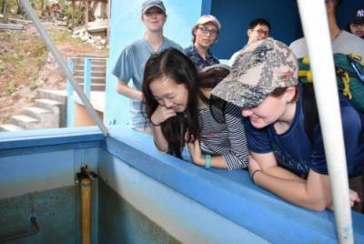 Students in Honduras looking at a water treatment plant