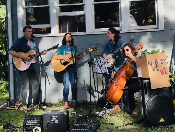 Rohini and her bandmates playing music at PorchFest in Ithaca