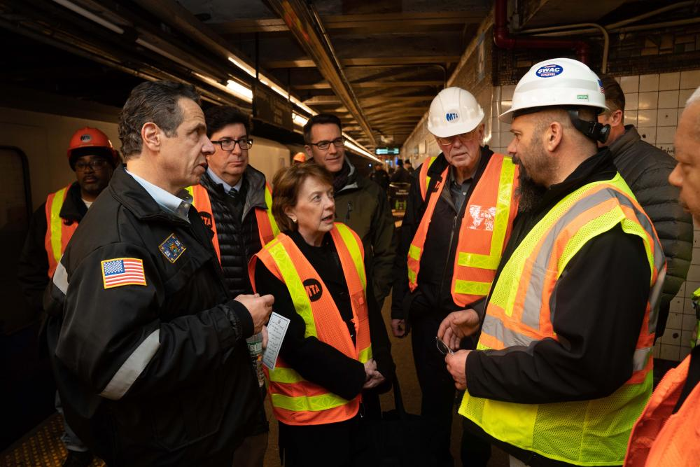 Engineers and Cuomo in tunnel