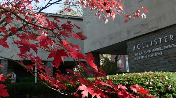 red autumn leaves on tree in front of Hollister hall