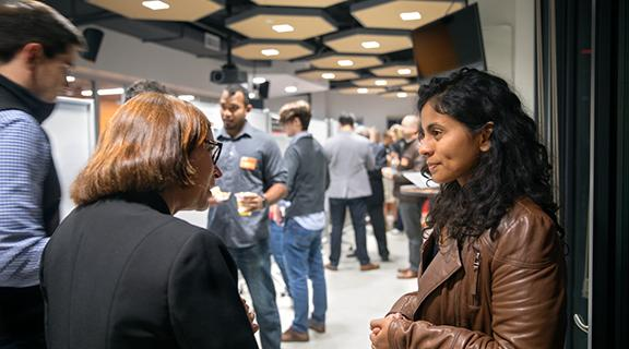 student talking with others at a career fair
